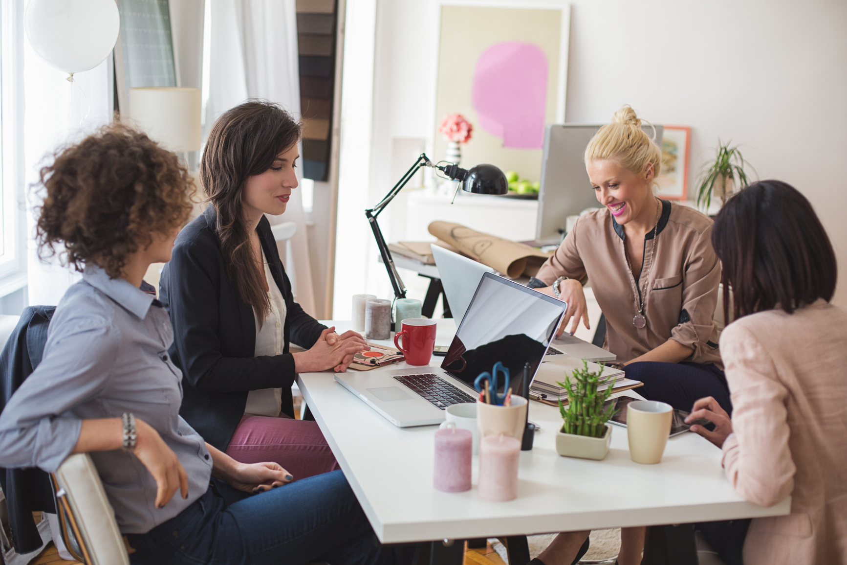 Group of businesswomen in a casual business meeting.
